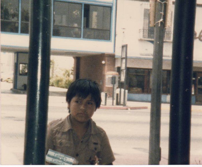 Little boy selling Chiclets gum in Tijuana, circa 1986